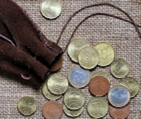 time is money - pile of coins from leather pouch